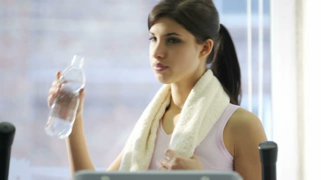 Young Woman Drinking Water After Exercising; HD Photo JPEG video