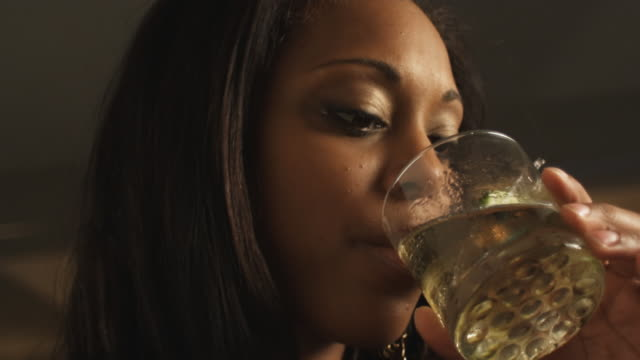 Young woman drinks and gives seductive look video
