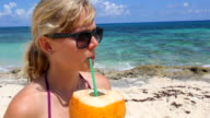 Young Woman Drinks from Coconut video