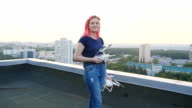 Young woman drives drone video