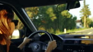 Young woman driving at sunset video