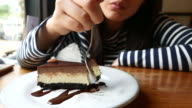 Young woman Eating Chocolate cheese Cake video