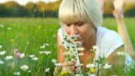 HD DOLLY: Young Woman Enjoying Lying On Grass video