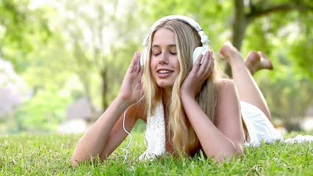 Young Woman Enjoying Music In Garden video
