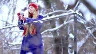 Young woman enjoying winter landscape video