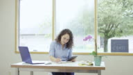 Young woman entrepreneur working in her office growing her business video