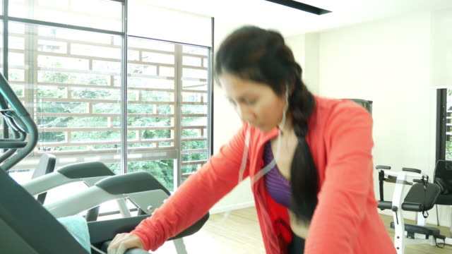 Young woman exercise in health club video