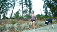Young woman exercising and running on field video
