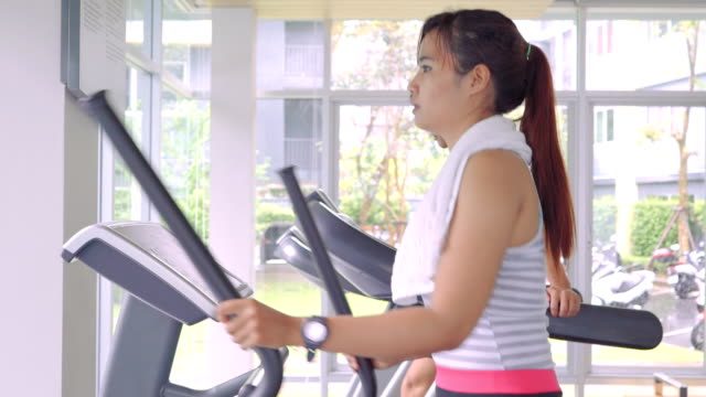Young woman exercising at gym video