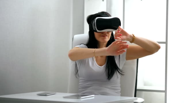 Young Woman experience with virtual reality video