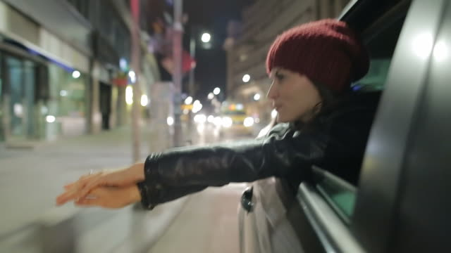 Young woman experiences freedom on the city streets. video