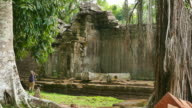 Young Woman Exploring Old Ruin of Angkor Temple in Cambodia video
