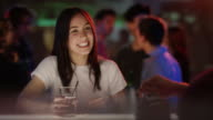 Young woman flirting with barkeeper video