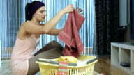 HD DOLLY: Young Woman Folding Laundry video