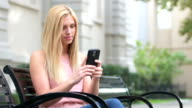 Young woman gaming with her mobile phone video