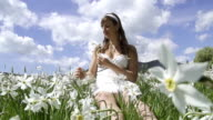 SLOW MOTION: Young woman gathering flowers video