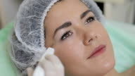 Young woman getting ultrasonic facial cleansing in cosmetology salon video