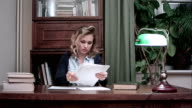 Young woman going through papers and making notes video