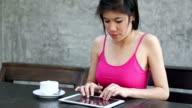 young woman got headache after using digital tablet computer video