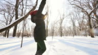 Young woman having fun in the winter park in slow motion. video