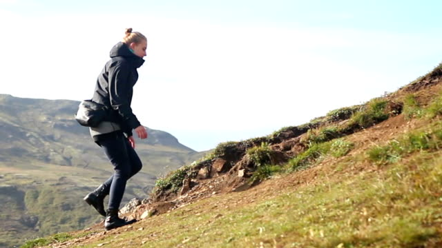 Young woman hiking the mountain in Iceland video