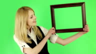 Young woman holding a frame video
