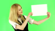 Young woman  holding a white blank board video