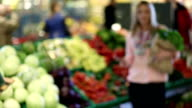 Young woman holding groceries bag. video