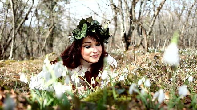 Young woman in a wreath of ivy video