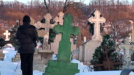 Young woman in cemetery during winter time video