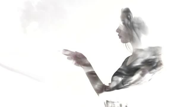 Young woman in evening dress gestures with a gun video