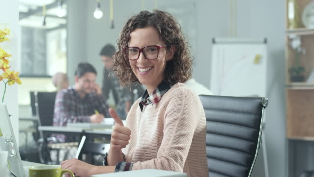 Young woman in office video