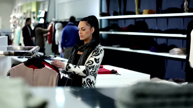 Young woman in retail store video