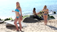young woman in swimsuits standing on  beach video