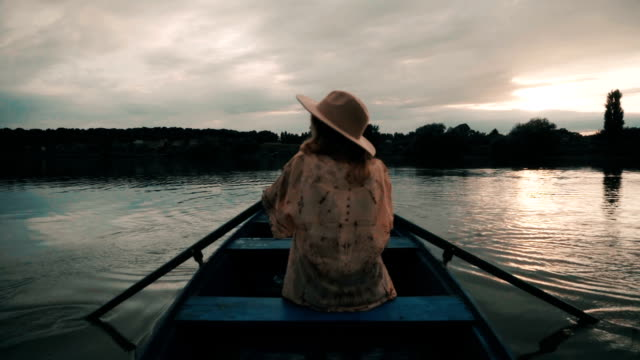 Young woman in the boat video