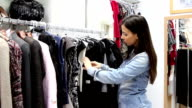 Young woman in the clothing store video