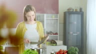 Young woman in the kitchen video