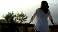 Young woman in the morning looking at beautiful view, outdoors video