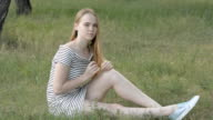 Young woman in the park. video