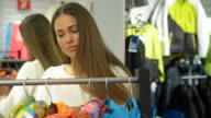 Young woman in the shopping mall. video