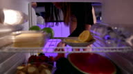 Young woman in underwear takes cake from the fridge video