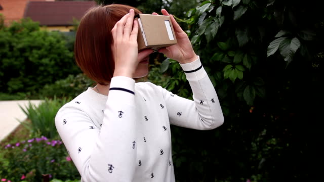 Young Woman in Virtual Reality Glasses cardboard. VR 360 video
