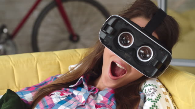 Young Woman in VR Headset Making Silly Face video
