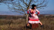 Young Woman In White Dotted Dress Posing At Nature video