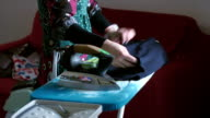 young woman ironing at home video