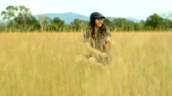 young woman is joyful on Savannah field video