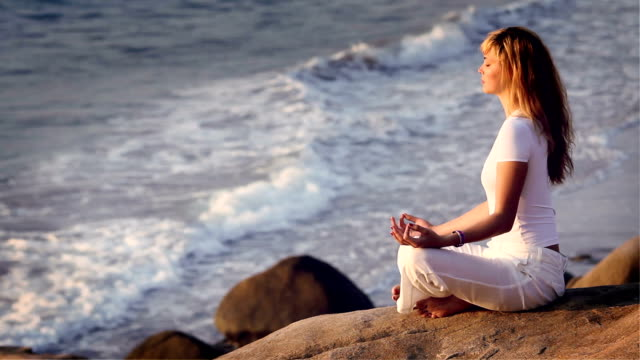 Young woman is practising the yoga. video