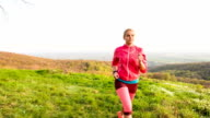 Young woman jogging in nature video