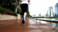 SLO MO Young woman Jogging in the park, Sport concept video