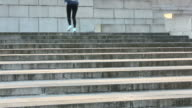 Young woman jogging on stairs video